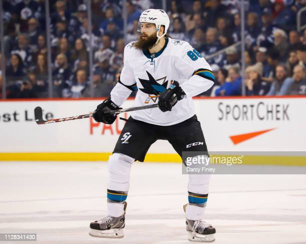 Brent Burns of the San Jose Sharks keep an eye on the play during first period action against the Winnipeg Jets at the Bell MTS Place on February 5...