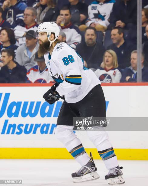 Brent Burns of the San Jose Sharks keeps an eye on the play during first period action against the Winnipeg Jets at the Bell MTS Place on March 12...