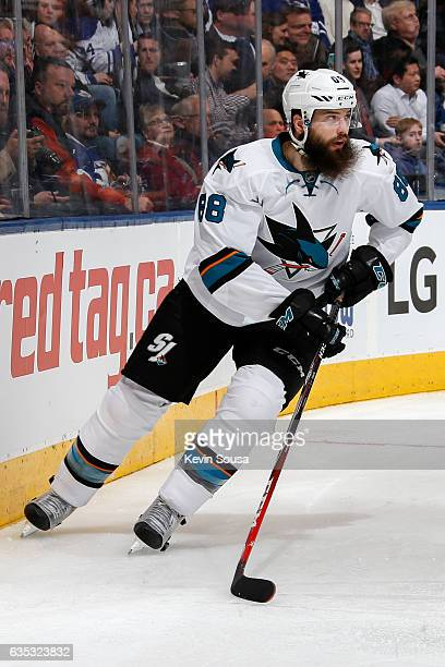 Brent Burns of the San Jose Sharks moves the puck against the Toronto Maple Leafs during the second period at the Air Canada Centre on December 13...