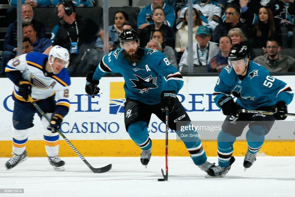 Brent Burns #88 of the San Jose Sharks moves the puck down the ice in front of Alexander Steen #20 of the St. Louis Blues and Chris Tierney #50 of the San Jose Sharks at SAP Center on March 8, 2018 in San Jose, California.