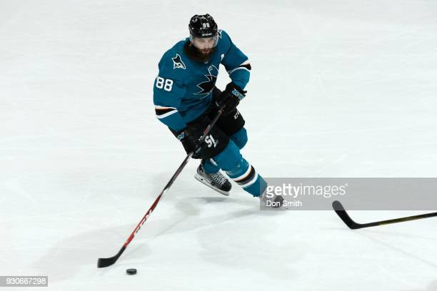 Brent Burns of the San Jose Sharks moves the puck during a NHL game against the Washington Capitols at SAP Center on March 10 2018 in San Jose...