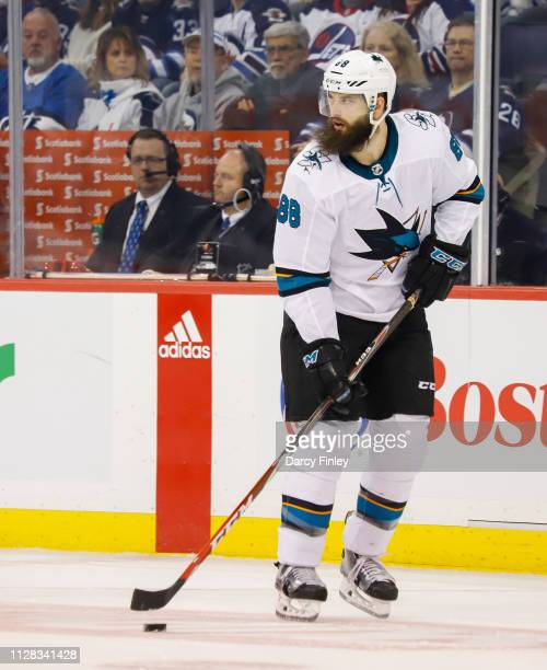 Brent Burns of the San Jose Sharks plays the puck up the ice during first period action against the Winnipeg Jets at the Bell MTS Place on February 5...