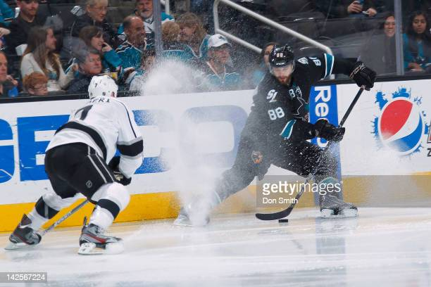 Brent Burns of the San Jose Sharks protects the puck against Rob Scuderi of the Los Angeles Kings at HP Pavilion on April 7 2012 in San Jose...