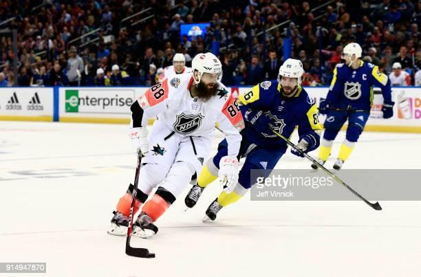 Brent Burns of the San Jose Sharks protects the puck from Nikita Kucherov of the Tampa Bay Lightning during the 2018 Honda NHL AllStar Game between...