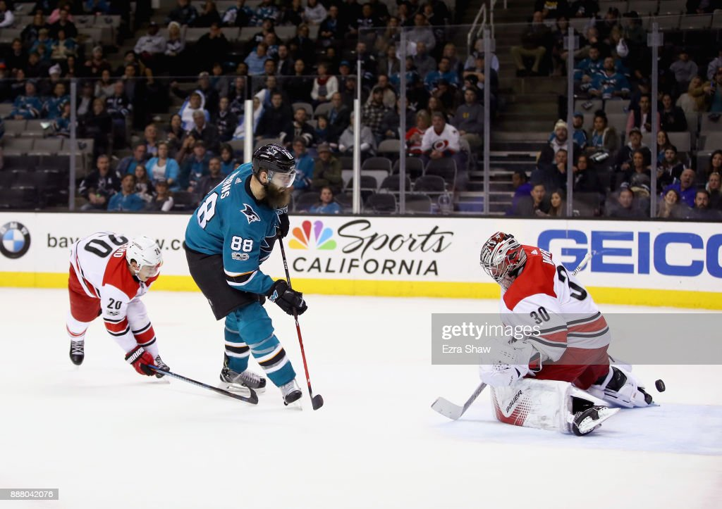 Brent Burns #88 of the San Jose Sharks scores the game-winning goal on Cam Ward #30 of the Carolina Hurricanes in overtime at SAP Center on December 7, 2017 in San Jose, California.