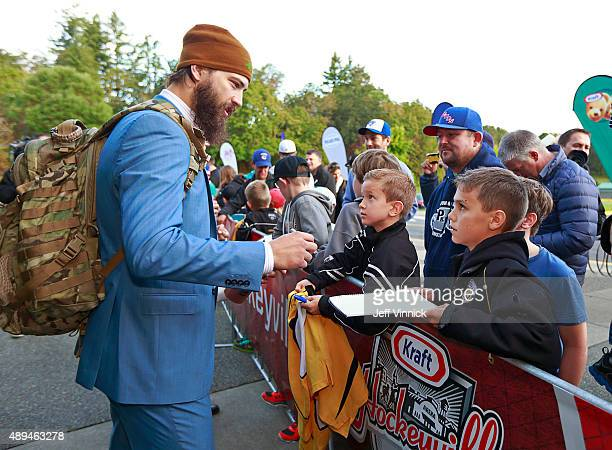 Brent Burns of the San Jose Sharks signs autographs for fans during Day 3 of NHL Kraft Hockeyville at the Q Centre on September 21 2015 in Colwood...