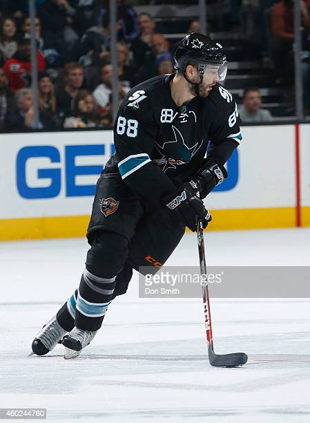 Brent Burns of the San Jose Sharks skates after the puck against the Boston Bruins during an NHL game on December 4 2014 at SAP Center in San Jose...