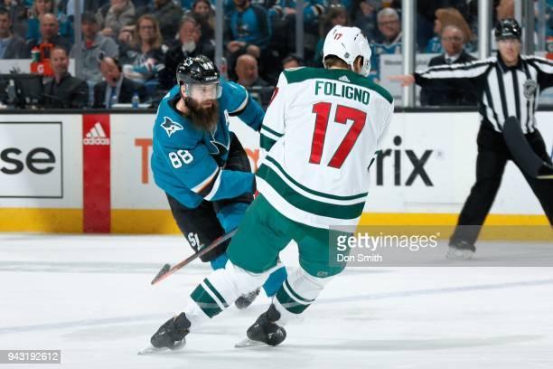 Brent Burns of the San Jose Sharks skates against Marcus Foligno of the Minnesota Wild at SAP Center on April 7 2018 in San Jose California