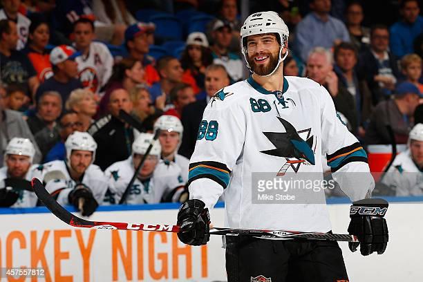 Brent Burns of the San Jose Sharks skates against the New York Islanders at Nassau Veterans Memorial Coliseum on October 16 2014 in Uniondale New...