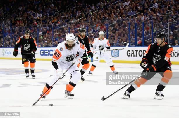 Brent Burns of the San Jose Sharks skates away from John Klingberg of the Dallas Stars during the first half 2018 Honda NHL AllStar Game between the...