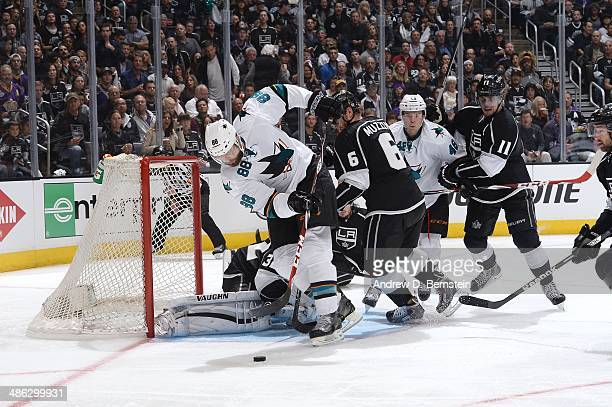 Brent Burns of the San Jose Sharks skates in the crease against Jake Muzzin of the Los Angeles Kings in Game Three of the First Round of the 2014...
