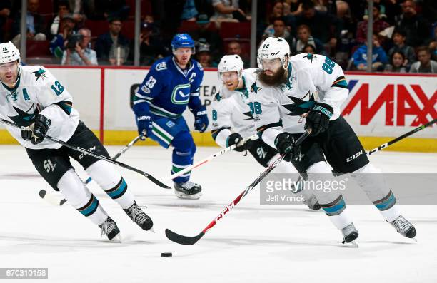 Brent Burns of the San Jose Sharks skates up ice with the puck during their NHL game against the Vancouver Canucks at Rogers Arena April 2 2017 in...