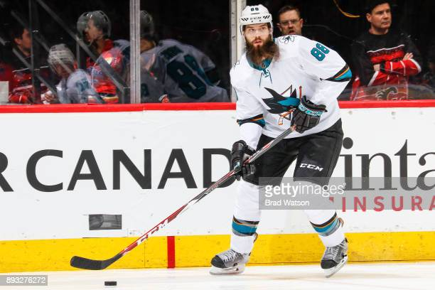 Brent Burns of the San Jose Sharks skates with the puck in a game against the Calgary Flames at the Scotiabank Saddledome on Saturday night