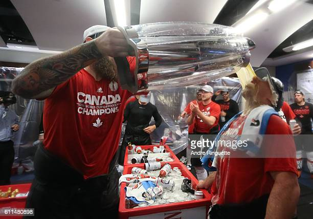 Brent Burns pours some beer from the cup for Brad Marchand of Team Canada during Game Two of the World Cup of Hockey final series between Team Canada...