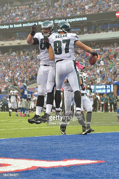 Brent Celek and Lane Johnson of the Philadelphia Eagles celebrate a touchdown against the New York Giants at MetLife Stadium on October 6 2013 in...
