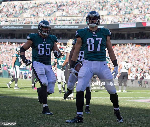 Brent Celek and Lane Johnson of the Philadelphia Eagles celebrate after Celek scored a touchdown in the third quarter against the New Orleans Saints...