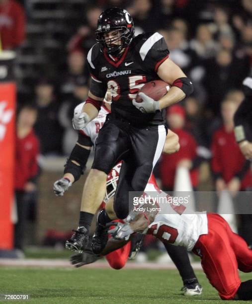 Brent Celek of the Cincinnati Bearcats jumps over Manny Collins of the Rutgers Scarlet Knights and continues on for a touchdown during the game on...