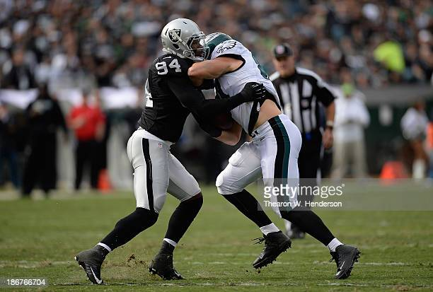 Brent Celek of the Philadelphia Eagles gets wrapped up by Kevin Burnett of the Oakland Raiders during the second quarter at Oco Coliseum on November...
