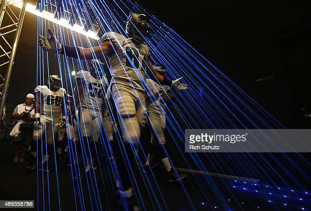 Brent Celek of the Philadelphia Eagles leads his team out of the tunnel before a football game against the Dallas Cowboys at Lincoln Financial Field...