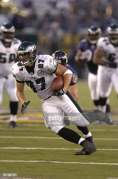 Brent Celek of the Philadelphia Eagles runs with the ball against the Baltimore Ravens on August 13 2007 at MT Bank Stadium in Baltimore Maryland