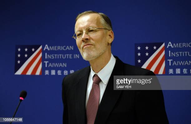 Brent Christensen director of American Institute in Taiwan listens during a press conference in Taipei on October 31 2018