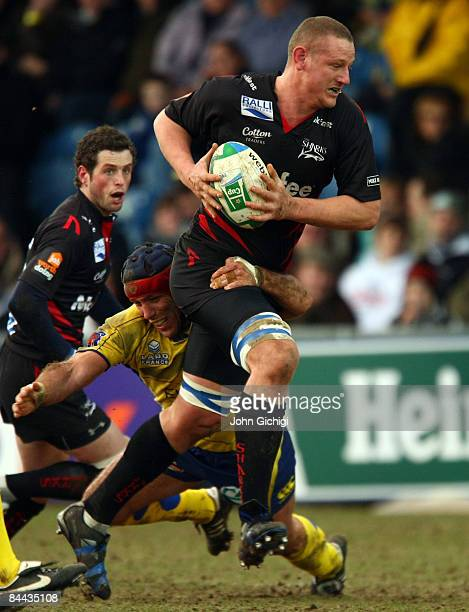 Brent Cockbain of Sale is tackled during the Heineken Cup game between Sale Sharks and ASM Clermont Auvergne at Edgeley Park on January 24, 2009 in...