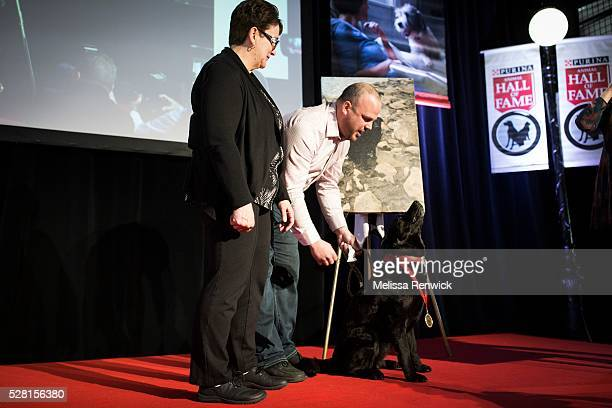 TORONTO ON MAY 03 Brent Cote and his mother Trudy stand on stage with their dog Raya who was added to the Purina Animal Hall of Fame at the 48th...