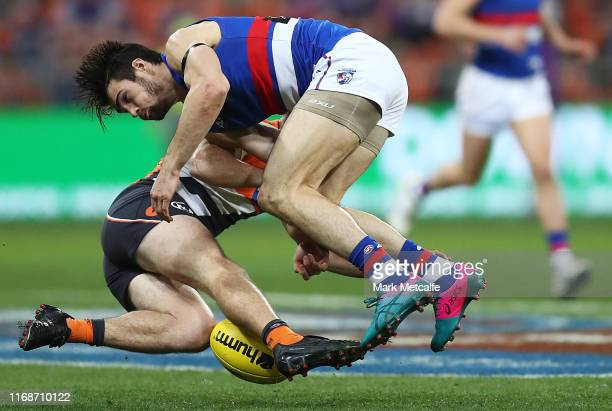 Brent Daniels of the Giants and Easton Wood of the Bulldogs clash competing for the ball during the round 22 AFL match between the Greater Western...