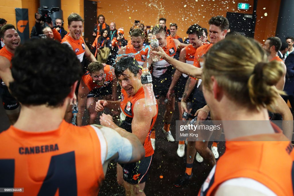 Brent Daniels of the Giants and team mates celebrate victory after the round 17 AFL match between the Greater Western Sydney Giants and the Richmond Tigers at Spotless Stadium on July 14, 2018 in Sydney, Australia.