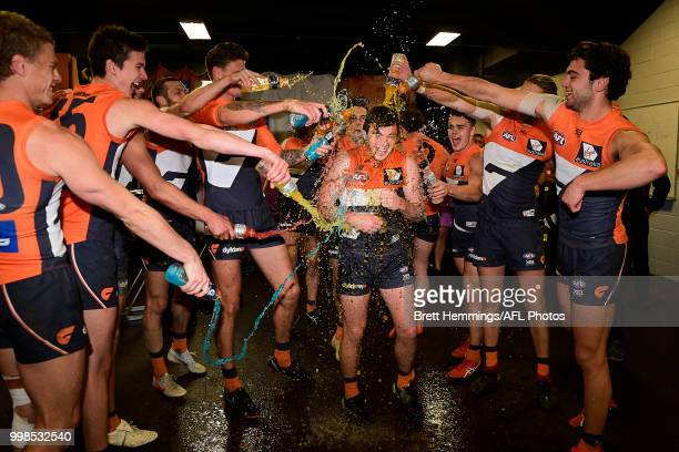 Brent Daniels of the Giants celebrates victory with team mates during the round 17 AFL match between the Greater Western Sydney Giants and the...