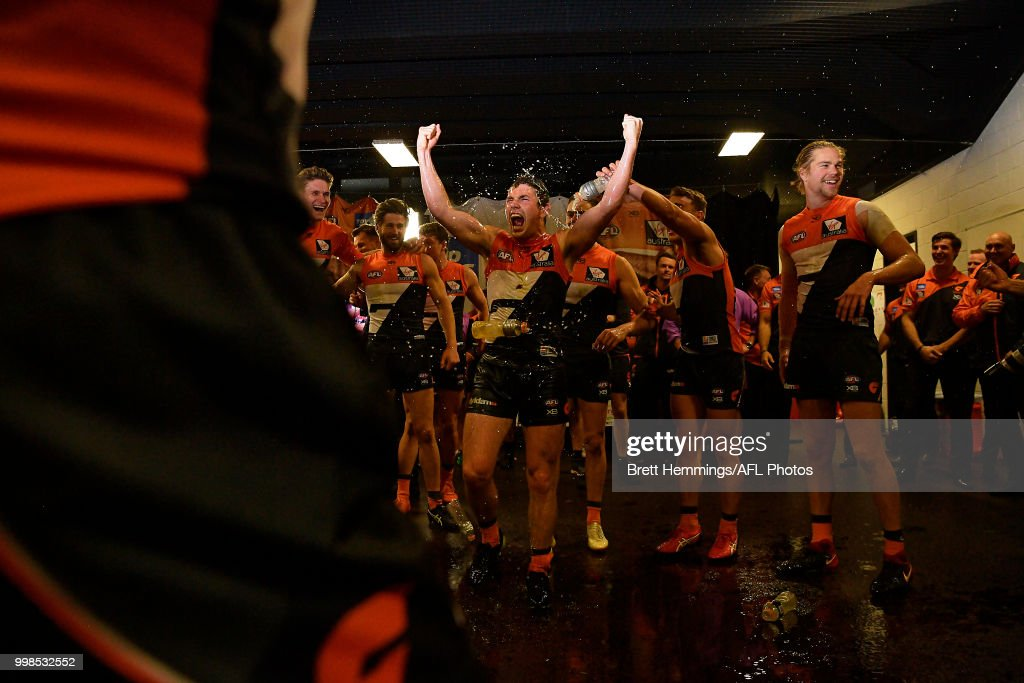 Brent Daniels of the Giants celebrates victory with team mates during the round 17 AFL match between the Greater Western Sydney Giants and the Richmond Tigers at Spotless Stadium on July 14, 2018 in Sydney, Australia.