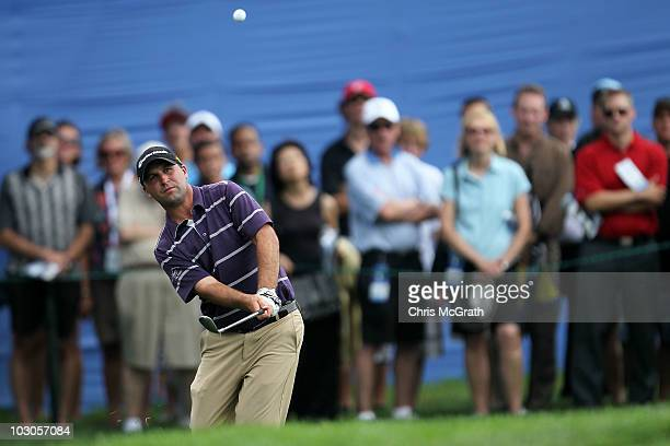 Brent Delahoussaye chips onto the 18th green during round two of the 2010 RBC Canadian Open at St. George's Golf and Country Club on July 23, 2010 in...
