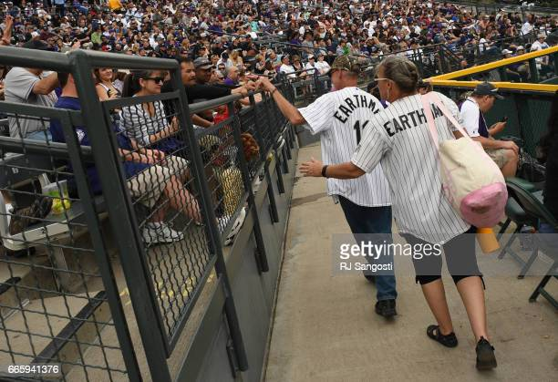 Brent Doeden aka 'Captain Earthman' and his wife Becky Scharfenberg leave Coors Field during the Colorado Rockies' home opener Coors Field on April 7...