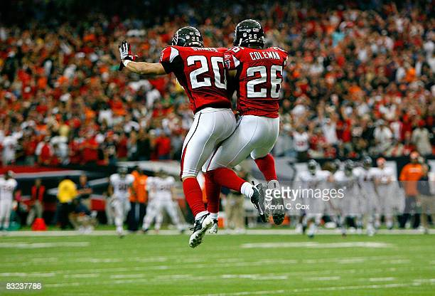 Brent Grimes and Erik Coleman of the Atlanta Falcons celebrate after a defensive stop on fourth down in the red zone against the Chicago Bears during...