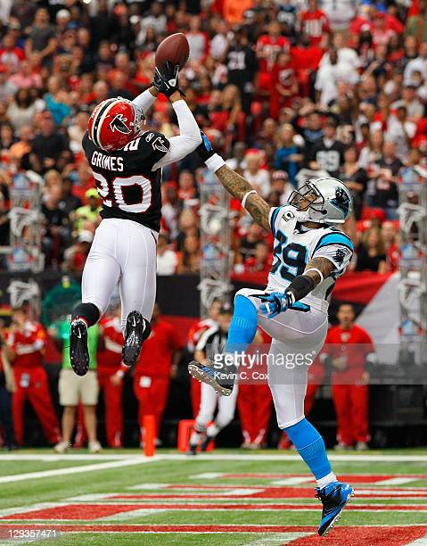 Brent Grimes of the Atlanta Falcons intercepts this touchdown reception that was tipped but intended for Steve Smith of the Carolina Panthers at...