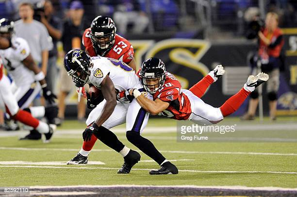 Brent Grimes of the Atlanta Falcons tackles Mark Clayton of the Baltimore Ravens August 28, 2008 at M&T Bank Stadium in Baltimore , Maryland.