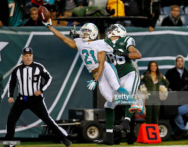 Brent Grimes of the Miami Dolphins breaks up a pass intended for David Nelson of the New York Jets during their game at MetLife Stadium on December 1...