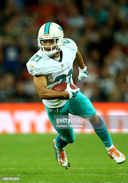 Brent Grimes of the Miami Dolphins carries the ball during the NFL match between the Oakland Raiders and the Miami Dolphins at Wembley Stadium on...