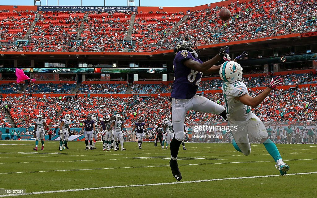 Brent Grimes #21 of the Miami Dolphins commits pass interference on Torrey Smith #82 of the Baltimore Ravens during a game at Sun Life Stadium on October 6, 2013 in Miami Gardens, Florida.