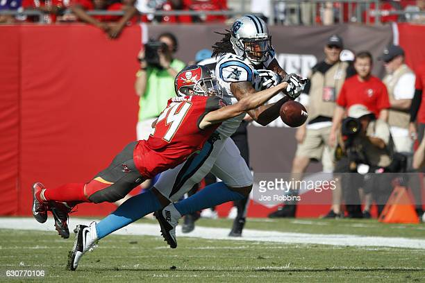 Brent Grimes of the Tampa Bay Buccaneers defends a pass against Kelvin Benjamin of the Carolina Panthers in the third quarter of the game at Raymond...