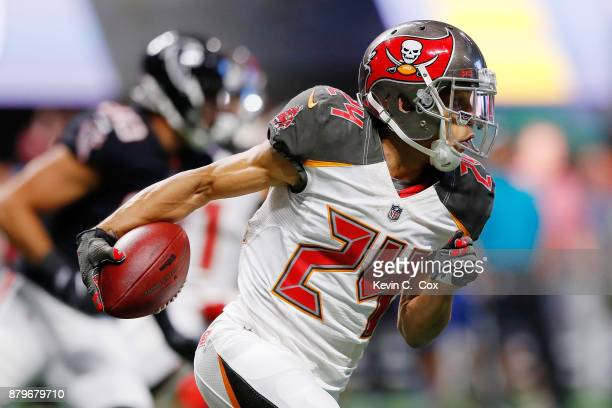 Brent Grimes of the Tampa Bay Buccaneers returns a fumble during the second half against the Atlanta Falcons at MercedesBenz Stadium on November 26...