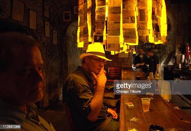 Brent Grulke of Austin Texas joins locals in the El Batey bar in San Juan Puerto Rico
