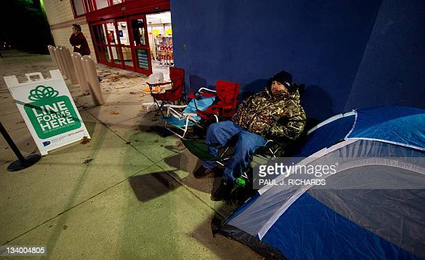 Brent Hart camps out with a tent in advance of Black Friday on the sidewalk of the Fair Lakes Best Buy store on November 23 2011 in Fairfax Virginia...