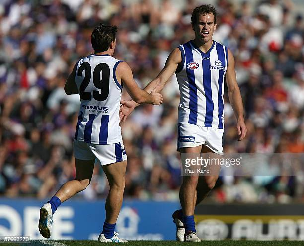 Brent Harvey and Corey Jones of the Kangaroos celebrate a goal during the round eight AFL match between the Fremantle Dockers and the Kangaroos at...