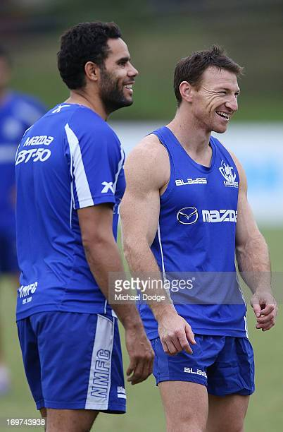 Brent Harvey and Daniel Wells react during a North Melbourne AFL Training Session on June 1 2013 in Melbourne Australia