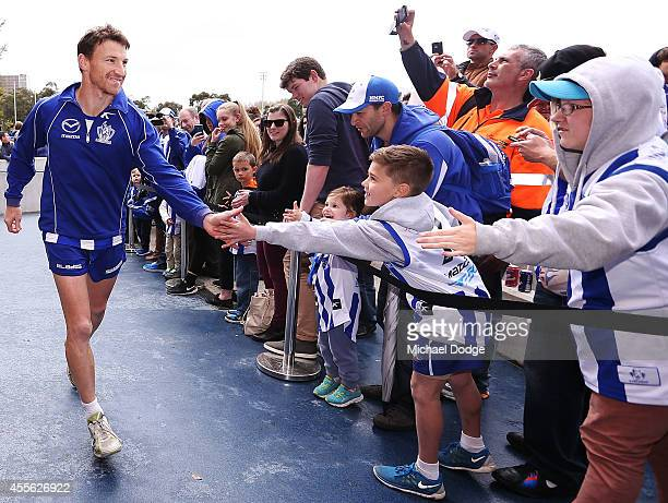 Brent Harvey gets a send off by fans after a North Melbourne Kangaroos AFL training session at Arden Street Ground on September 18 2014 in Melbourne...