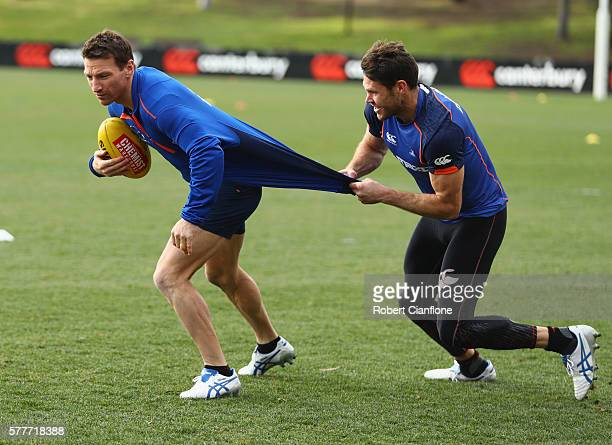 Brent Harvey is challenged by teammate Sam Gibson during a North Melbourne Kangaroos AFL training session at Arden Street Ground on July 20 2016 in...