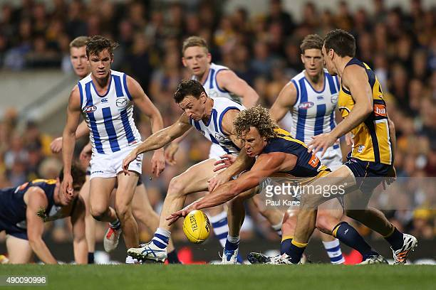 Brent Harvey of the Kangaroos and Matt Priddis of the Eagles contest for the ball during the AFL Second Preliminary Final match between the West...