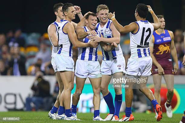 Brent Harvey of the Kangaroos celebrates after kicking a goal during the round 17 AFL match between the Brisbane Lions and the North Melbourne...