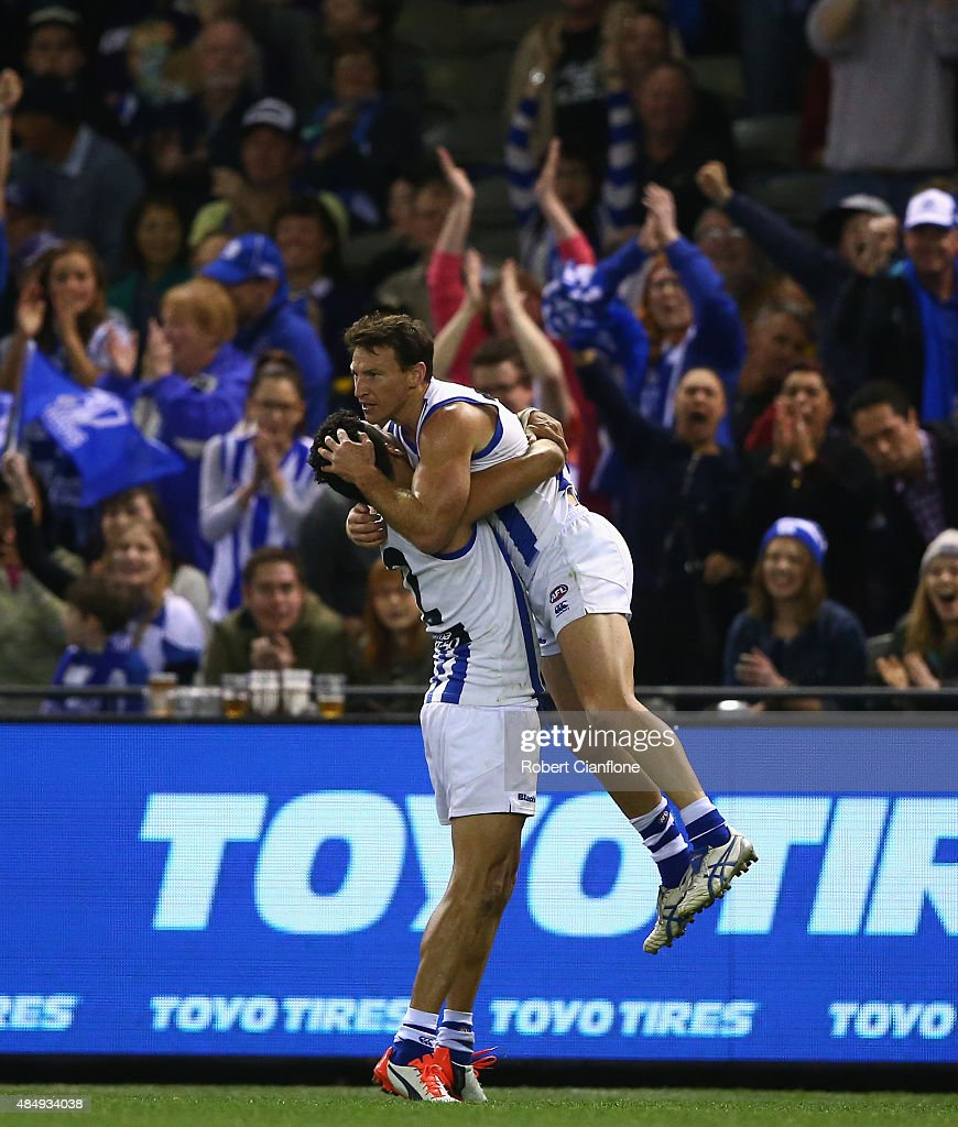 Brent Harvey of the Kangaroos celebrates after scoring a goal during the round 21 AFL match between the North Melbourne Kangaroos and the Fremantle Dockers at Etihad Stadium on August 23, 2015 in Melbourne, Australia.